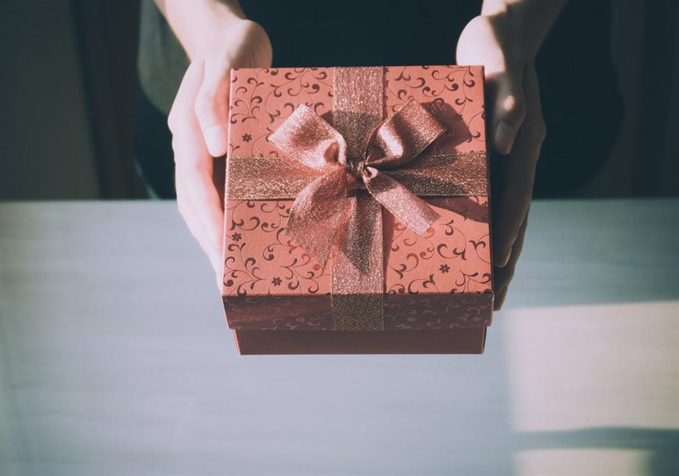 Person holding a gift