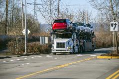 Open carrier truck moving cars cross country