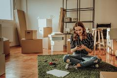 Young woman in her new apartment